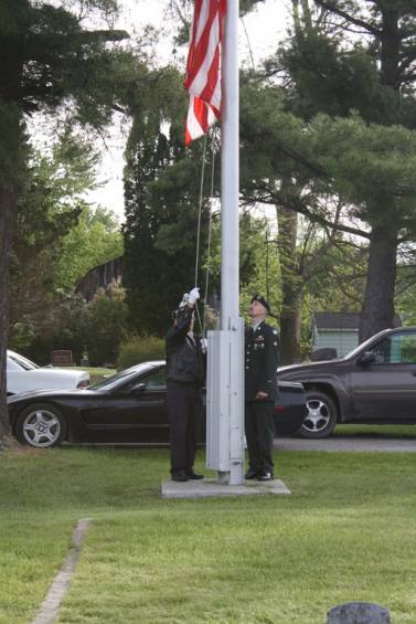 Veterans raise the flag at the Resurrection Cemetery in Standish May 27.
