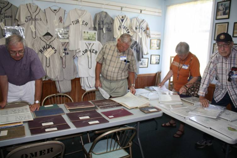 Attendees for the NEM reunion arrived early at the Ye Olde Courthouse in Omer to look through the museum records July 21.