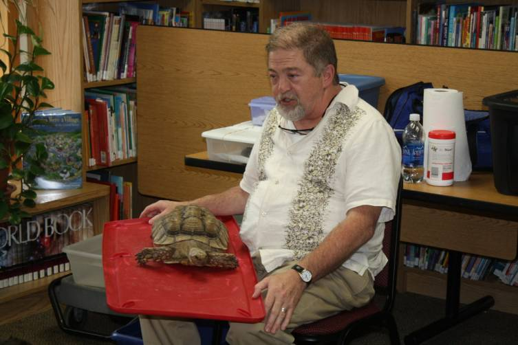 Michael Brophy opens his Reptiles Inc. show at the Mary Johnston Library July 25, with a Sahara Desert-native African spur-thighed tortoise named Trouble. He said the diurnal animal can live to be 100 years old, and that Trouble had been abandoned in March in Michigan by his owners. The tortoise had suffered from pneumonia and had a shell infection from a dog bite when it was found and nursed back to health.