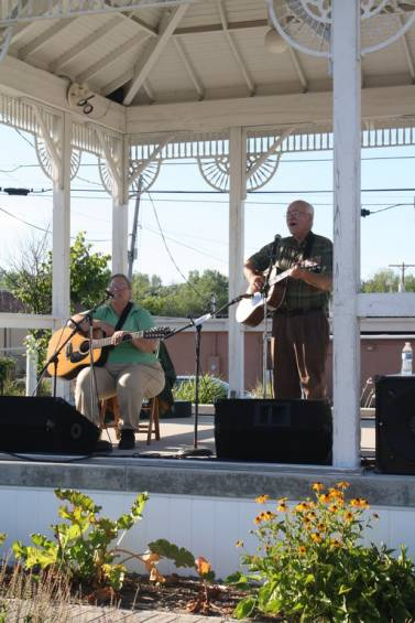 Yvette and Devin Chisholm perform on the bandstand at the Standish Historical Depot July 25, bringing acoustic Christian folk music to the listening audience.