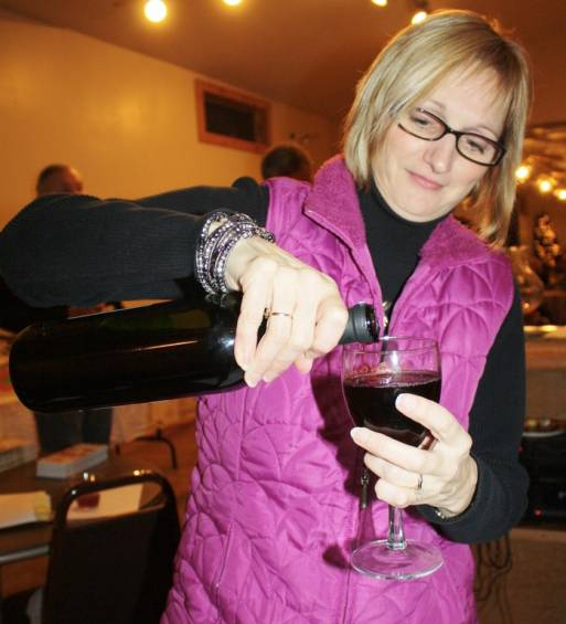 Volunteer Lorri Burzlaff pours a glass of wine to give to a wine tasting attendee. According to Chamber of Commerce President Ann Galbraith, there were more than 15 volunteers who helped put the event together this year.