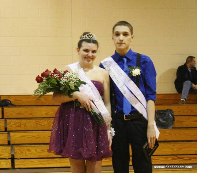Queen Amanda Papke and king Wyatt Nelson pose for photos after being named homecoming royalty.