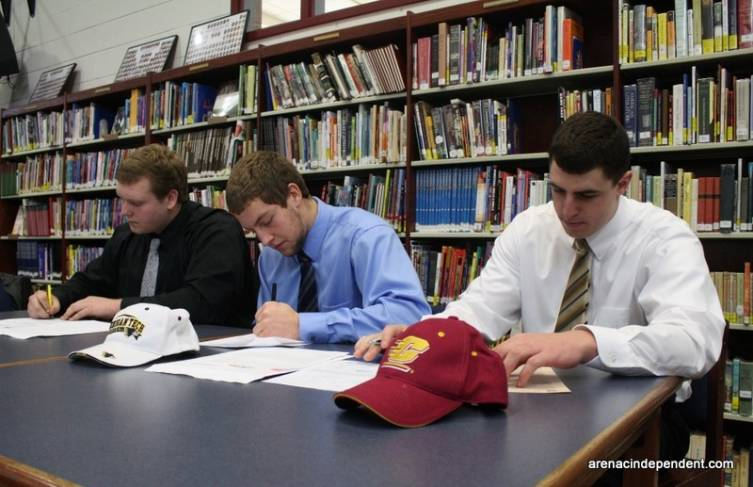 Anthony Prohaska, Seth Malcolm and Clay Walderzak sign letters of intent to play football in college next year.