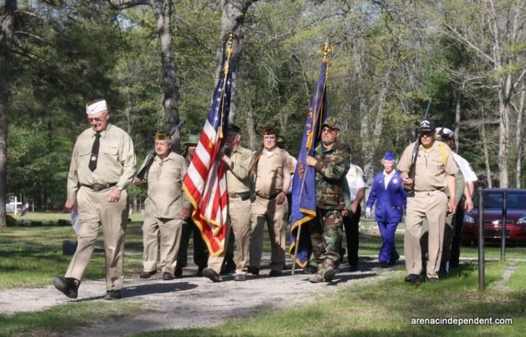 Members of he VFW and Ladies Auxiliary march toward their spots in the Memorial Day ceremony.