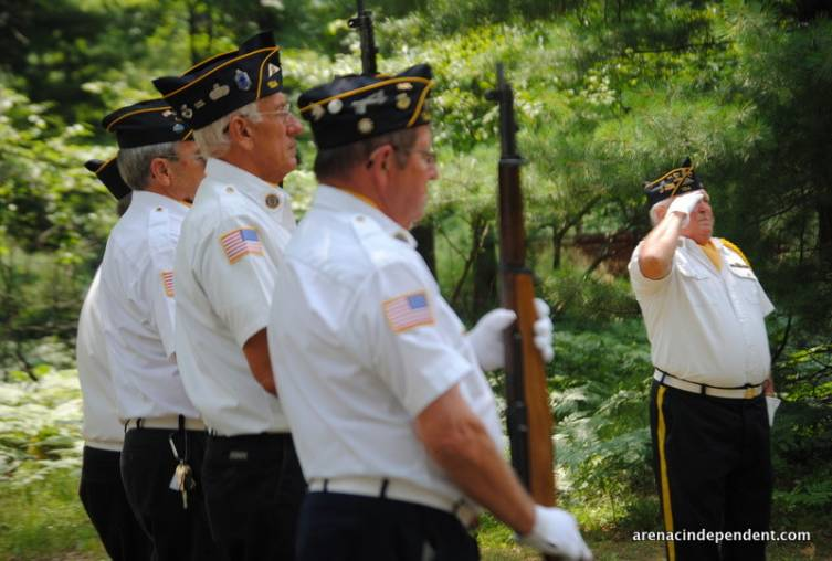 """Members of the firing squad stand at attention during """"Taps."""""""