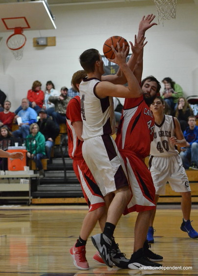 W-P's Shawn Edmonds defending the basket as AGS' Trent Jantzi goes up for the basket.