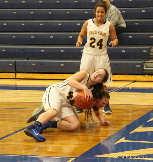 SSC's Cassidy Kraatz hits the floor and comes up with a loose ball.