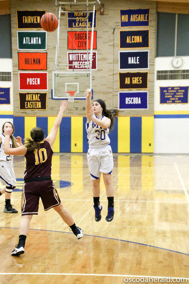 Claudia Wilson throws up a shot from behind the three point line for Mio AuSable Feb. 20.