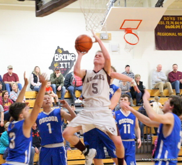 AGS' Cade Steelman creates some space and puts up a shot down low among a crowd of Owl defenders.