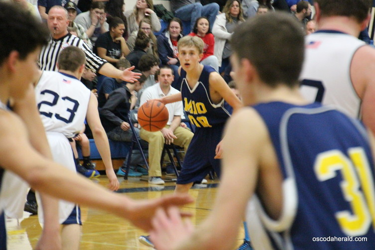 Junior Andrew Hager looks for an open teammate to pass the ball to.