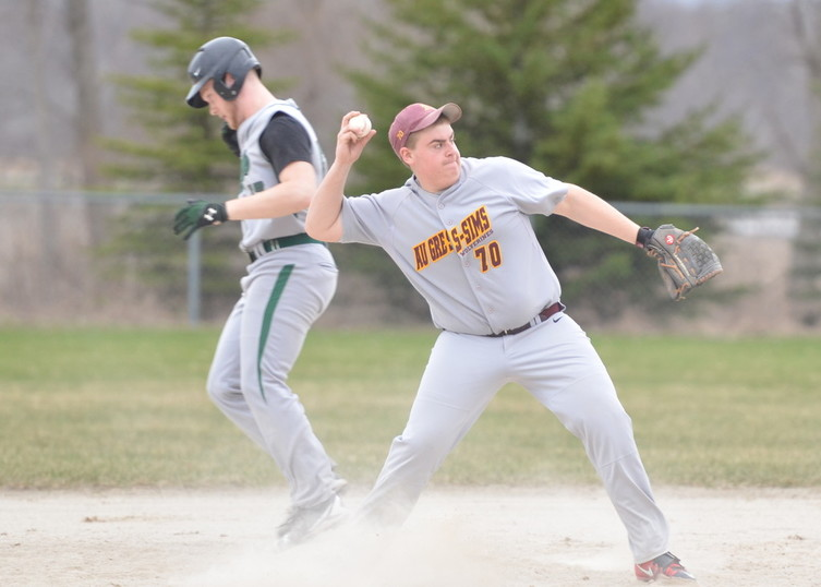 AGS' Kody Gordon throws the ball to first base looking for that double play.