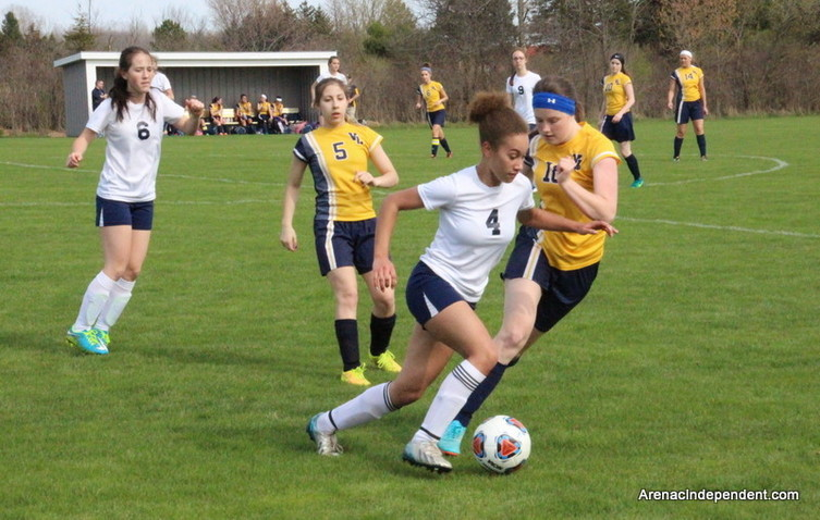 Standish's Johanna Davis looks to break outside with the ball.