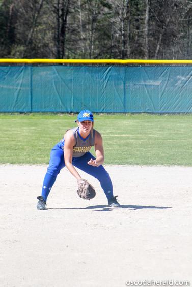 Mio's Emily Mangutz readies herself near first base.