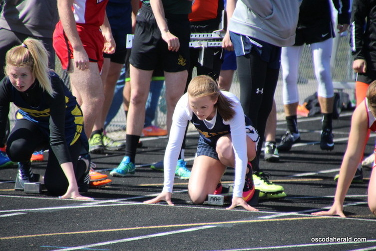 Mio AuSable runner Haley Fisher gets set in the blocks for the 100 meter dash.