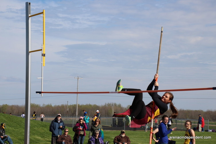 Kara Caulfield tries to get over the bar for Au Gres in the high jump.