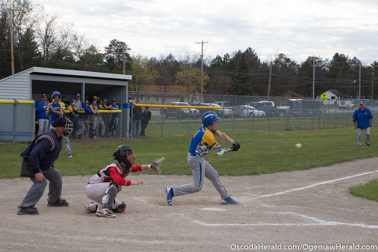 Mio's Brenden Deflorio begins to swing on an approaching fast pitch.