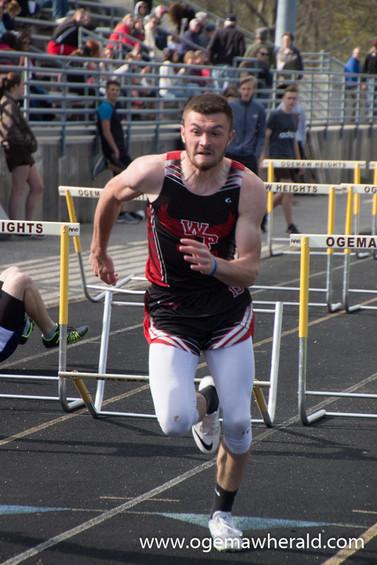 W-P's Kyle Colton races to get a leg up on the competition during the 110-meter hurdles.