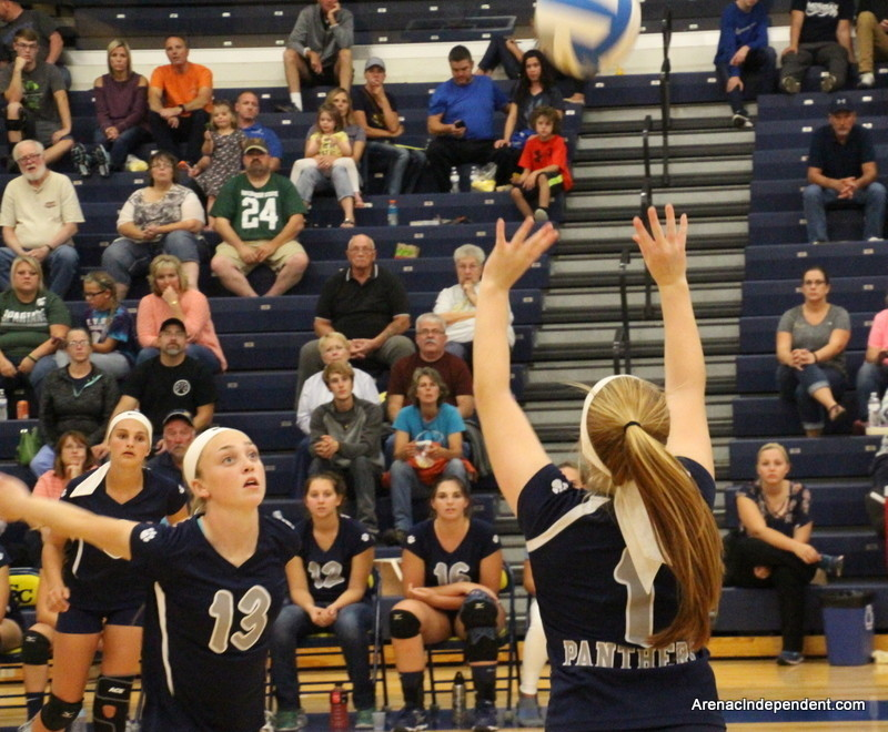 The Panthers' Lakin Fryzel (13) focuses on a set from Karleigh McBride (1) as she steps up for a kill attempt.