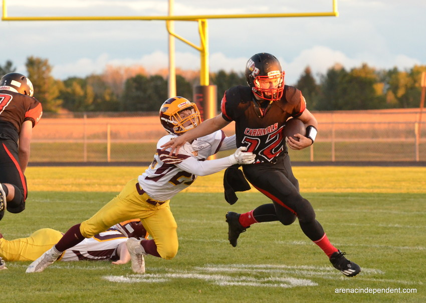 Whittemore-Prescott  Ridge Schutte gives a stiff arm to AGS' Jared Saunders.