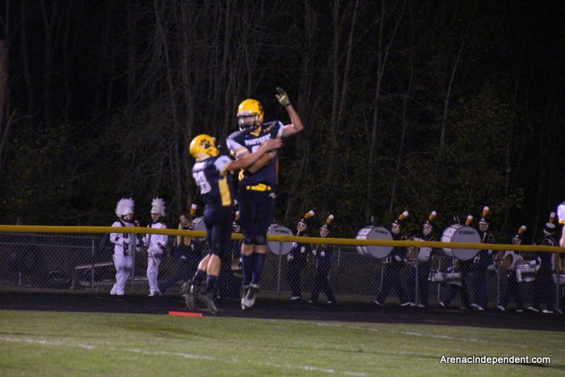 Jonny Urbaniak and Kenny Adrian celebrate an Adrian catch for a SSC touchdown.