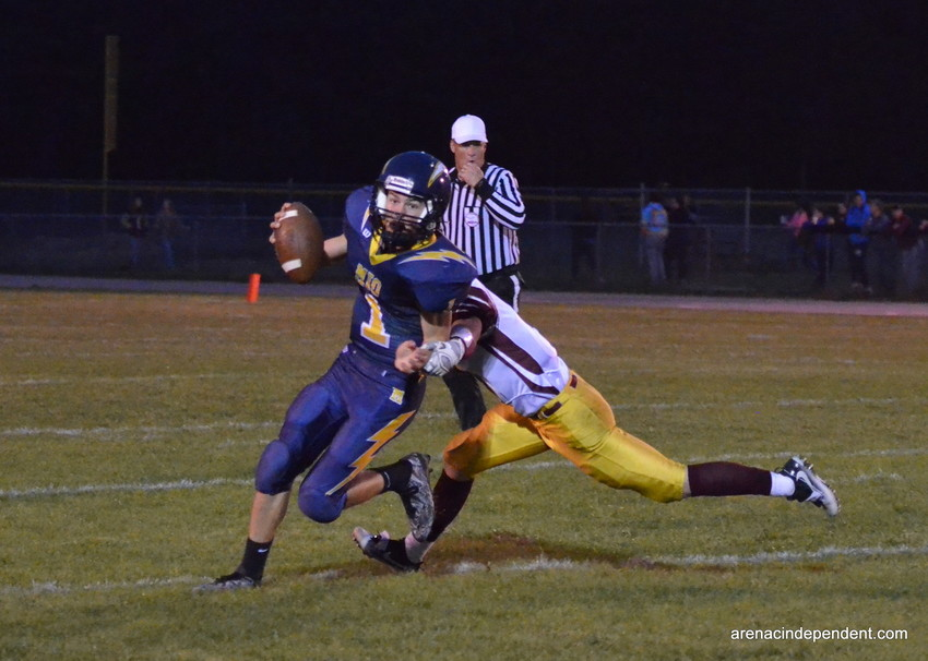 Mio's Brendan DeFlorio scrambles to make a pass as AGS' Ashmin Stamm goes in for the tackle.