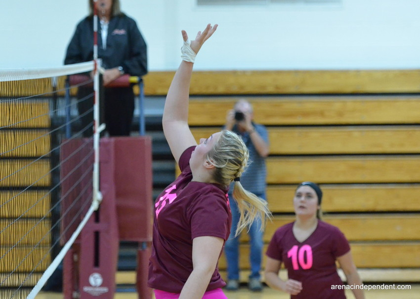 AGS' Gina Dewald sends the ball over the net.