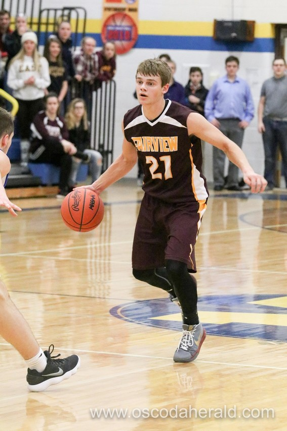 Fairview's Tylor Ross prepares to drive toward the basket.