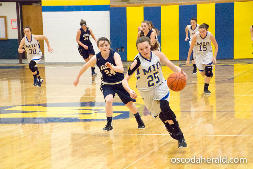 Jordan Butler races down the court after stealing the ball from Alcona.