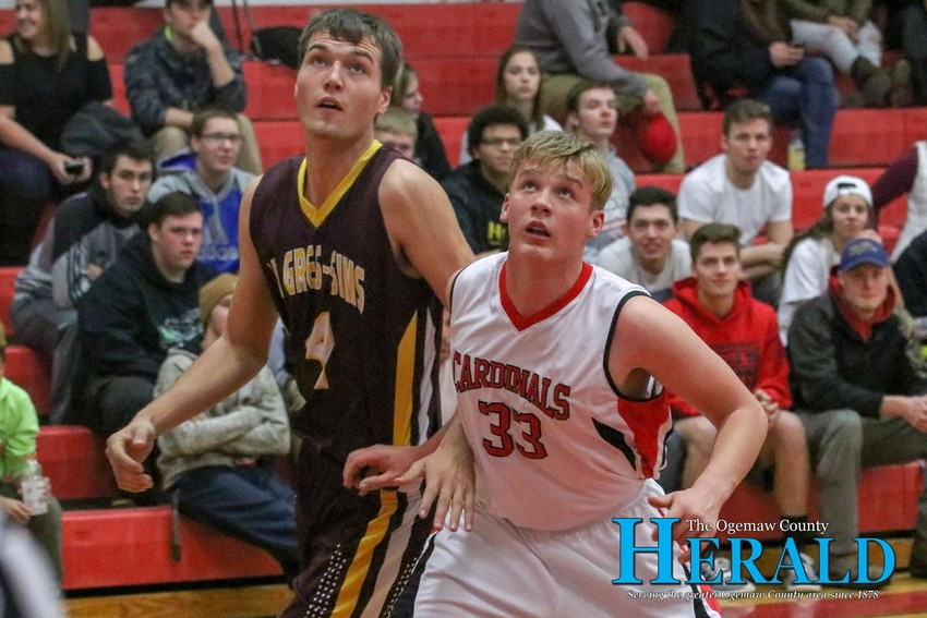 Whittemore's Michael Blust boxes out Au Gres' Trent Jantzi after a freethrow.