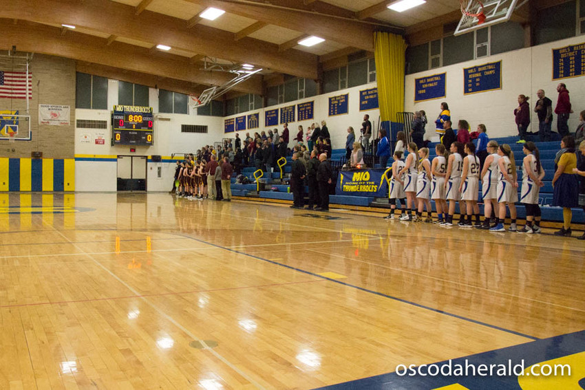 The Mio and Fairview girls basketball teams face the flag for the playing of the national anthem Jan. 16.