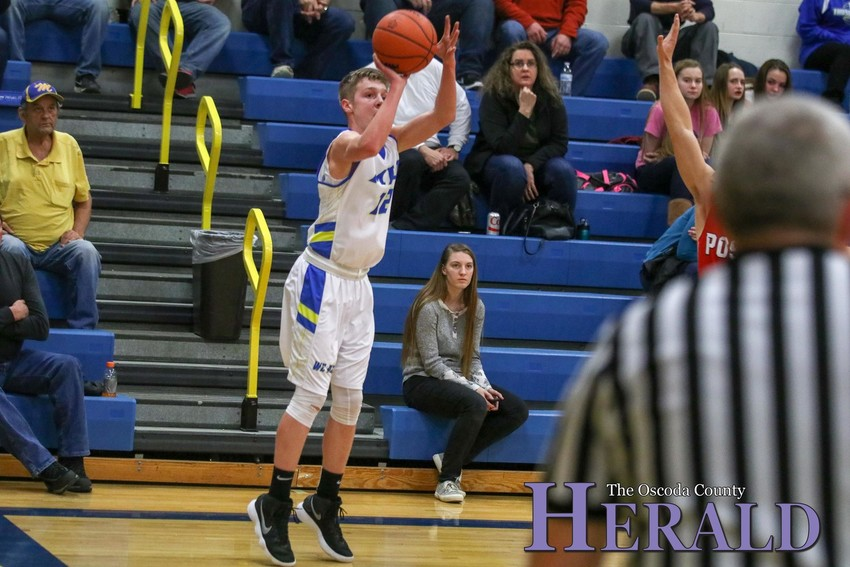 Mio's Drew Hess releases a three-point attempt.