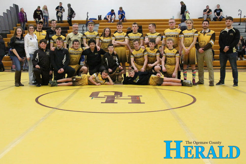 The Ogemaw Heights Falcons wrestling team celebrates its district title Feb. 7.