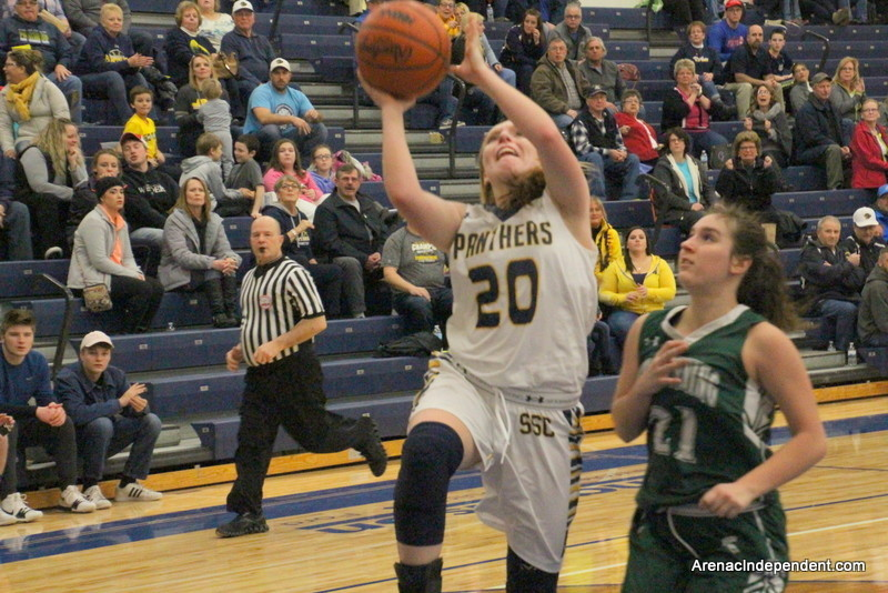 Karleigh McBride of Standish draws a foul and puts up a shot.