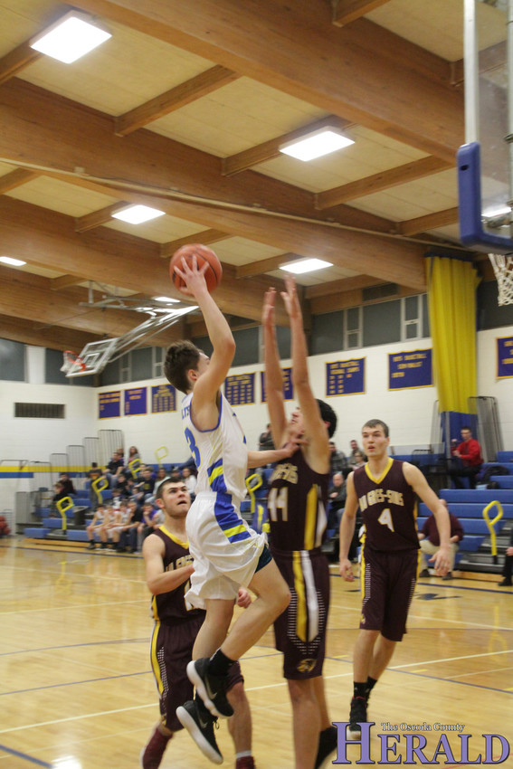 Mio's Collin Spies makes a jump shot, scoring for the Thunderbolts.