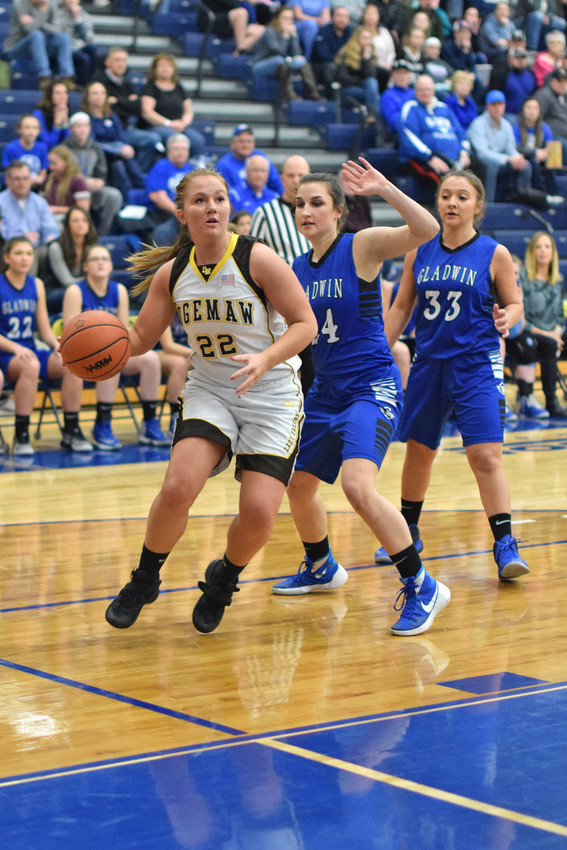Payton Izworski drives around (24) Lauren Seebeck on her way to the hoop.