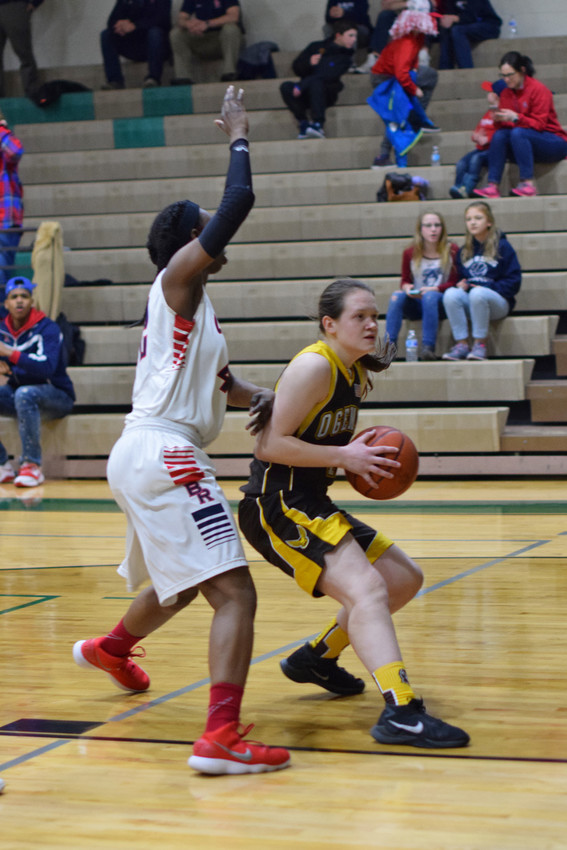 Megan Killingbeck drives toward the lane and turns around when she meets Jayla Strickland of Big Rapids.