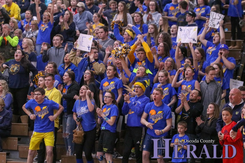 The Mio student section cheers on their team late in the game.