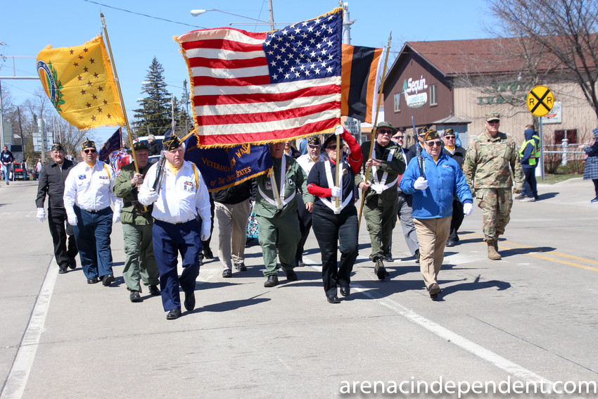 Veterans march in last year's parade.