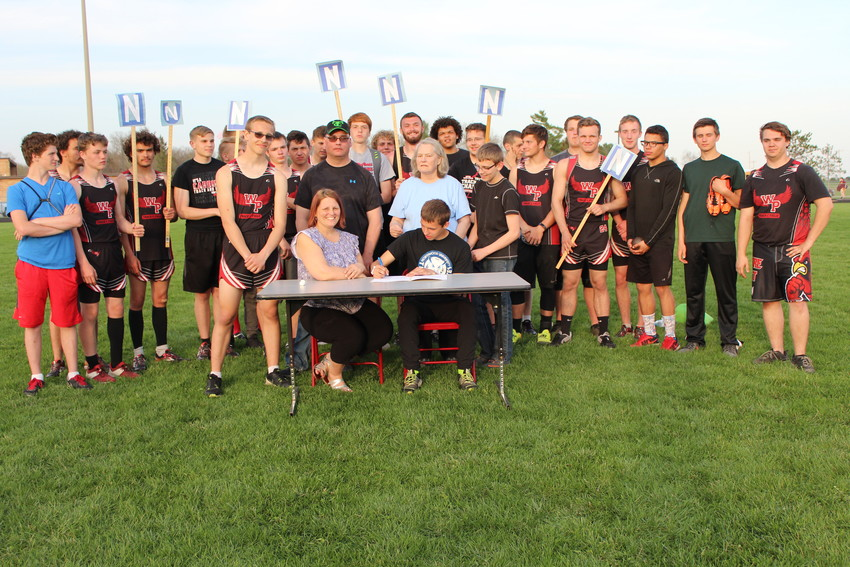 Aldrich signs his letter of intent surrounded by family and friends after the Cardinal Snowfest make-up meet May 8.