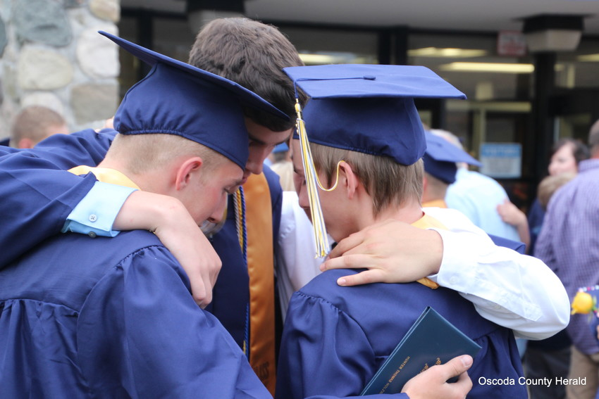 A group of Mio grads put their heads together one last time before leaving high school for the last time.