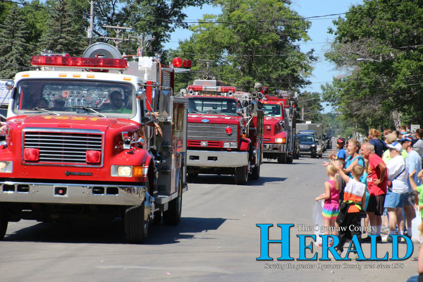 Several fire trucks wrap up the end of the parade.
