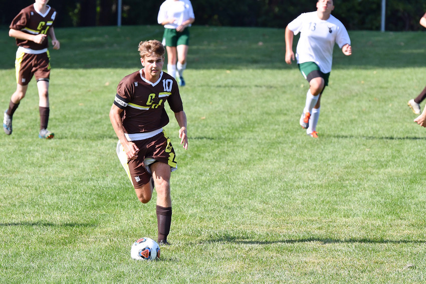Nick Marentette charges up the field with the soccer ball.