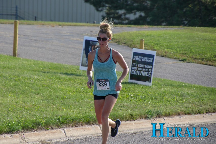 Rachel Brewer approaches the finish line.