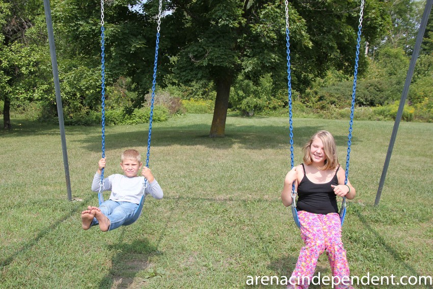 Elijah, 10, and Alyanna Webster, 11, of Standish enjoy the new swings Sunday, Aug. 26.