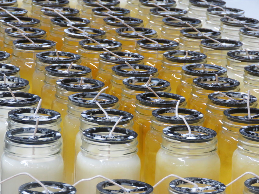 Fresh poured candles cool off as they are prepared to be sent to store shelves.