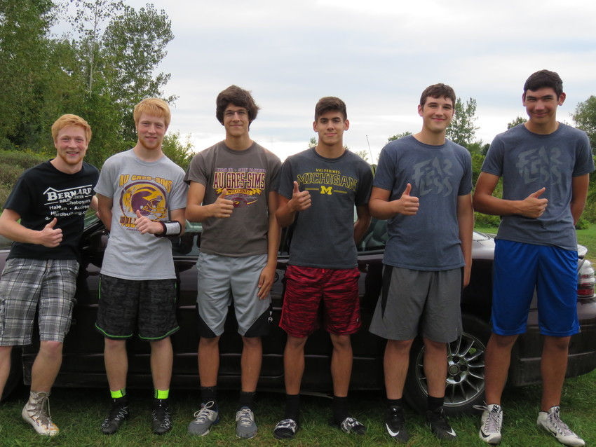The Au Gres-Sims twins pose next to their corresponding siblings. Standing from left to right are Zander and Fletcher Forton, Ryan and Bradly Schwiderson and Gabe and Isaac Beardsley.