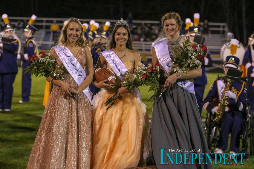 2018 SSC Homecoming Queen Kate Sullivan, center, poses for a photo with second runner-up Isabel Niernberg and first runner-up Ericka Bigham after being crowned during halftime of Fridays varsity football game.