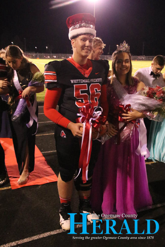 Homecoming King and Queen Brenden Woyahn and Sarah Larsen pose for a photo after being crowned.