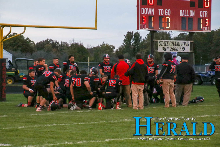 The Whittemore-Prescott Cardinals football team huddles up before the game Sept. 28.
