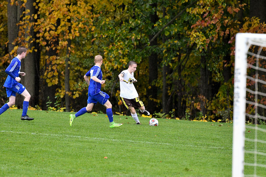 Dylan Finkbeiner kicks the ball to the center of the field.